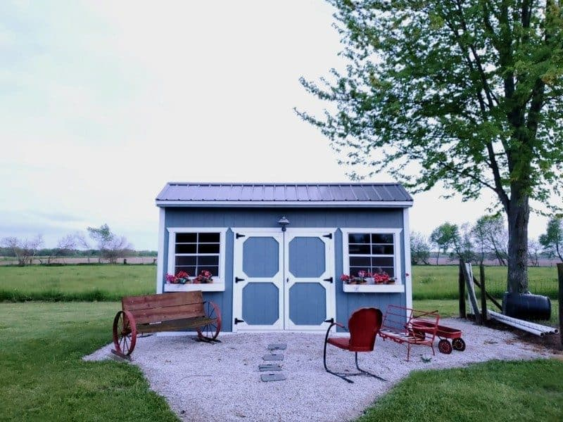 shed on gravel in a field