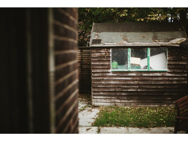 old wooden shed on a patio
