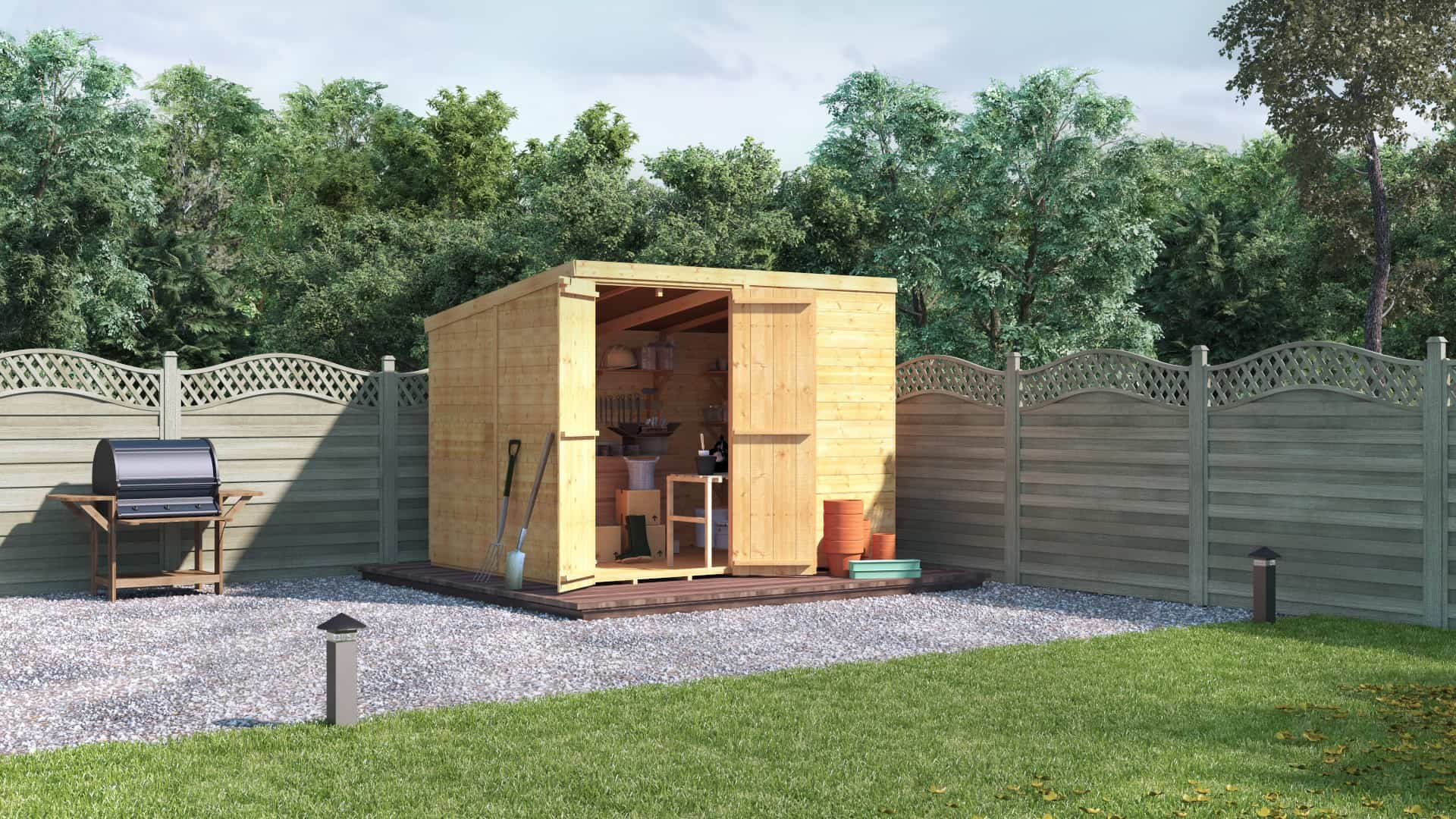 opened-doored Windowless pent tongue and groove timber shed on gravel against a fence boundary backed by trees