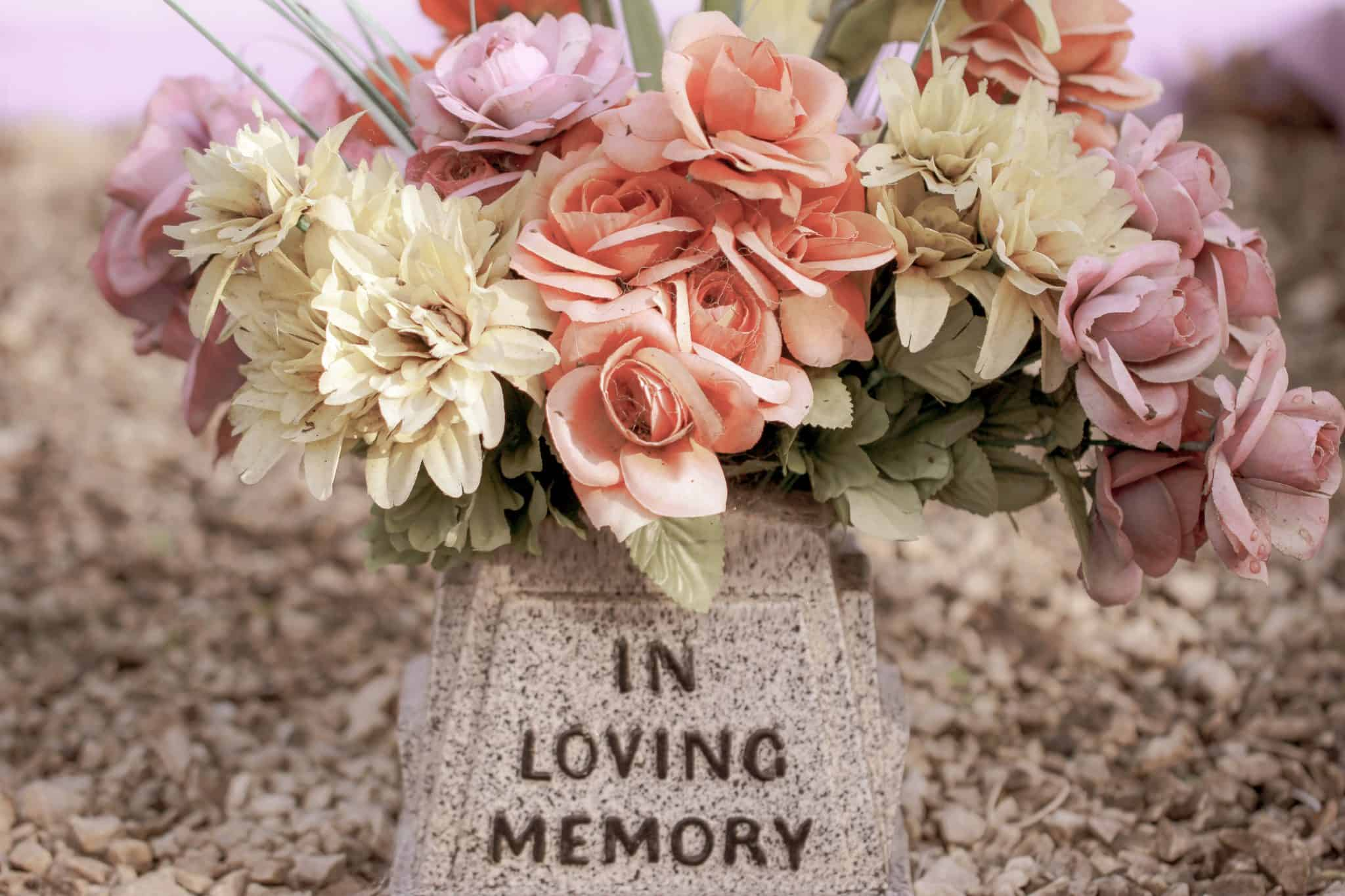 In Loving Memory memorial with flowers