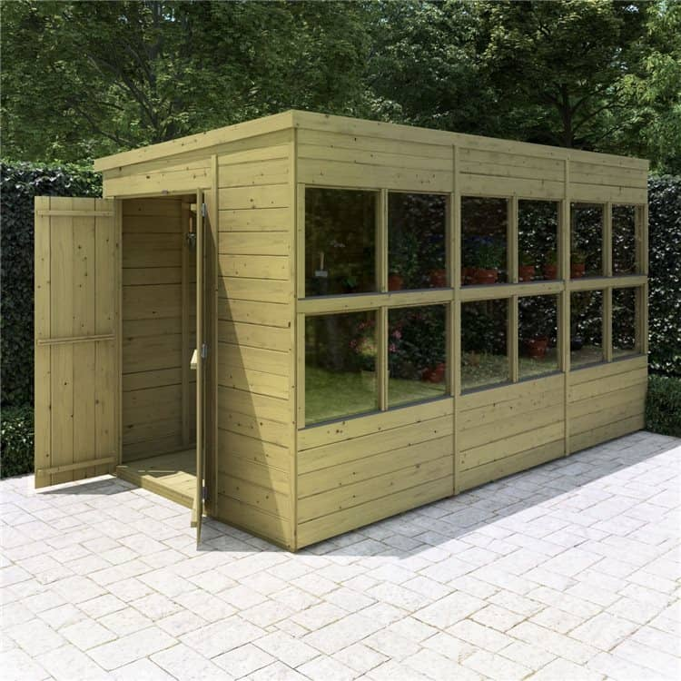 BillyOh planthouse pent roof timber shed with open doors on a stone patio